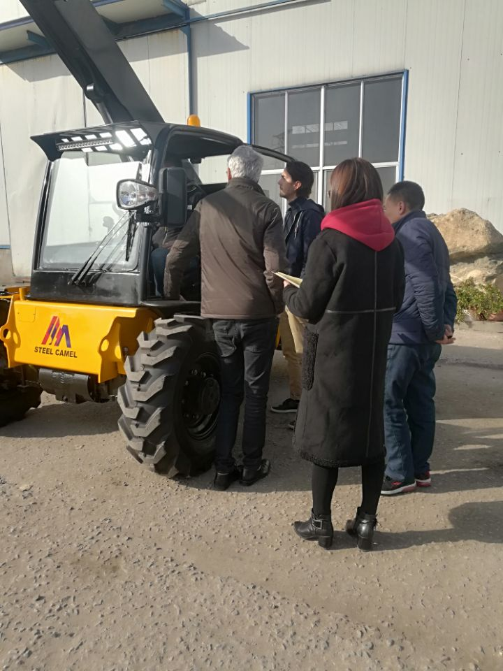 Customer from Sweden checking our telehandler machine